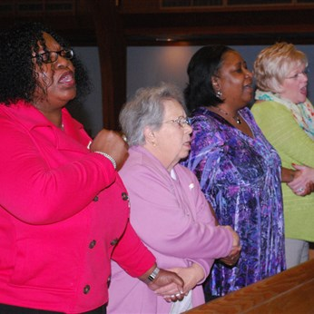 Everyone joined hands to sing one of the anthems from the civil rights movement,
