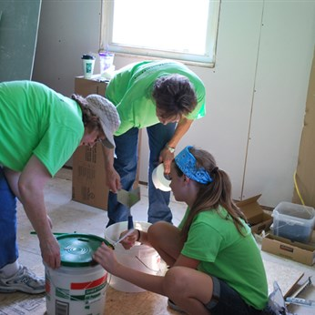 A group from Thousandsticks UMC in Red Bird Conference works at a home in West Liberty.