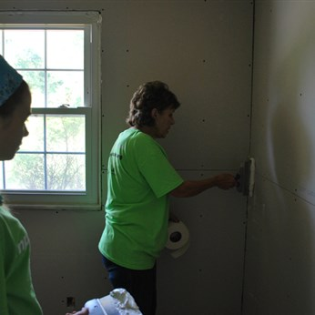Volunteers from Thousandsticks UMC in Red Bird Conference works at a home in West Liberty.
