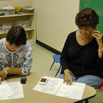 Volunteers work at a phone bank in Johnson County