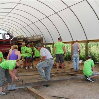 Volunteers at work on a barn in Pendleton County