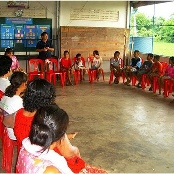 GBGM Country Director Cherlue Vang speaks with the children at the outreach